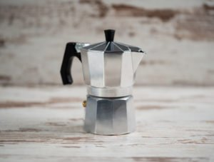Italian espresso machine over wooden background